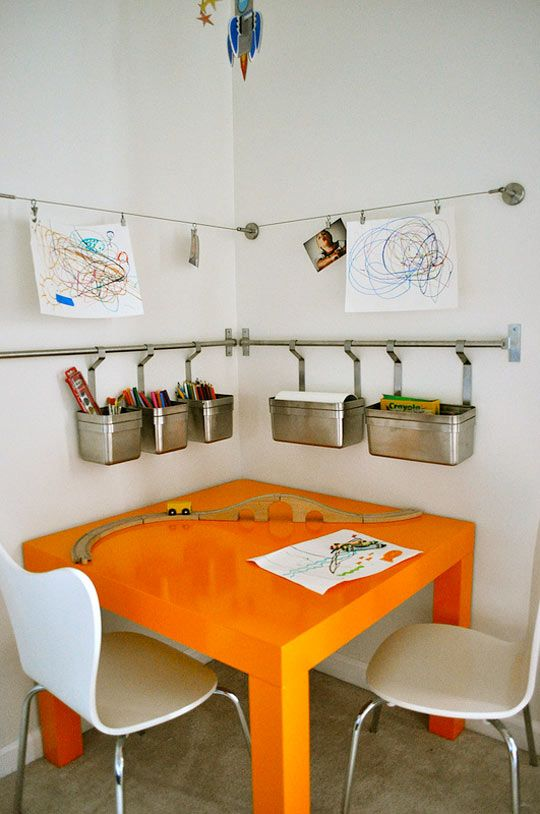 Our son's room is gonna be so difficult to decorate because the ceilings are sooooo angled. But I imagine we can get an art desk fit into one of the corners like this somehow. I love these hanging bins and mini clothesline for hanging presh art!