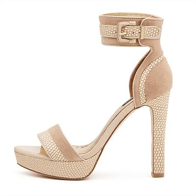 These towering platforms feature wide ankle straps and are the ultimate balance to slim silhouettes... #mimcomuse