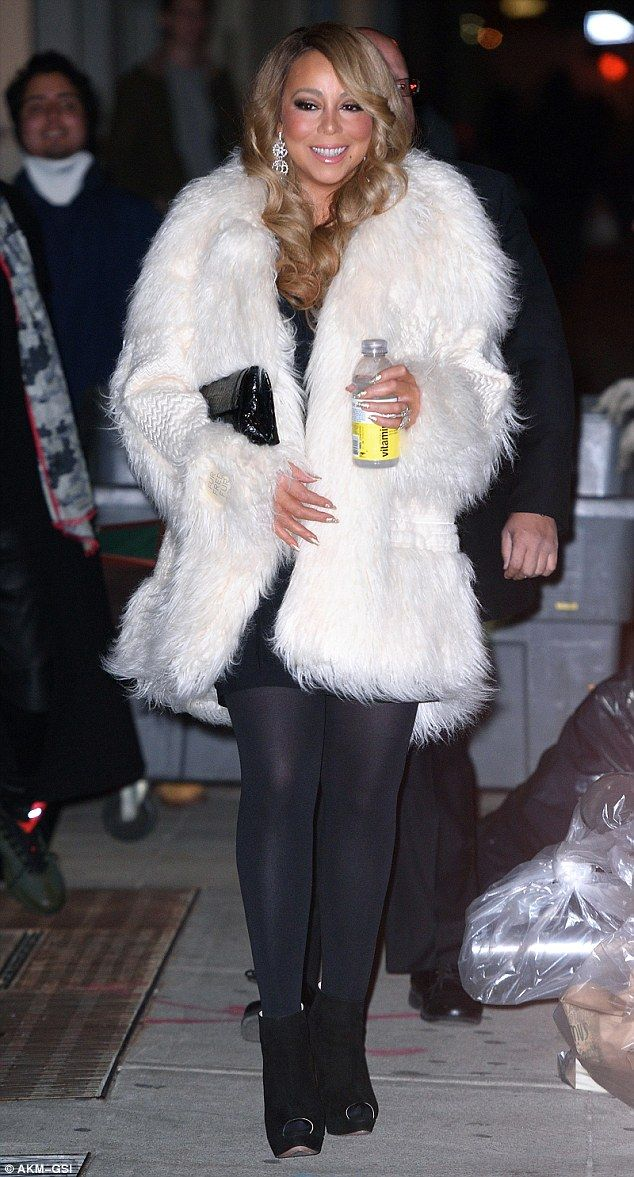 Furry-nice: Mariah Carey nailed the season's style once again on Friday as she stepped out in NYC
