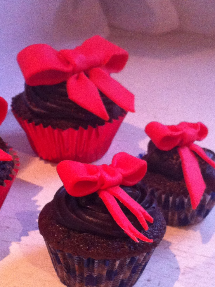 Cherry fondant bows on choc fudge cupcakes with chocolate ganache top
