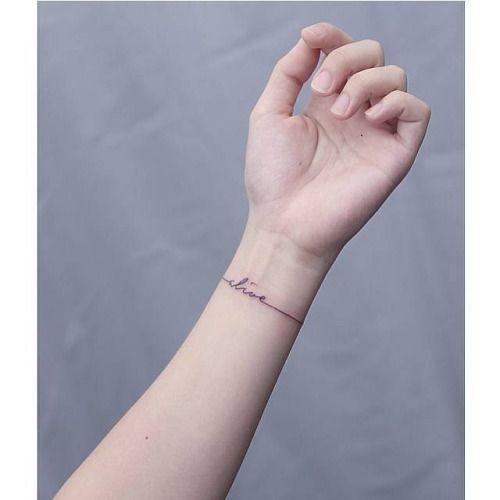 Wristband tattoo saying Alive. Tattoo artist: Mini...