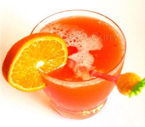 Bahama Mama - ¾ oz Coconut Rum (Malibu), ¾ oz Banana Liqueur (Hiram Walker), 1 oz Spiced Rum (Captain Morgan), 1.5 oz Orange Juice, 2.5 oz Pineapple Juice, 2-4 dashes (1-2 Tbs) Grenadine, ¼ cup crushed ice, Garnish: Orange/Pineapple wedge, 1 Maraschino Cherry (optional)... Combine all the ingredients and mix them in a cocktail shaker. Serve in a cocktail glass. Garnish with Orange/Pineapple wedge.