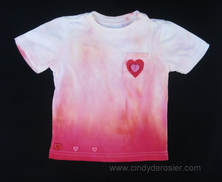 Anyone at any age who loves the color pink will fall in love with this adorable Little Girl's Ombre Homemade Tie Dye Shirt. Learn how to tie dye a shirt that you can give as a gift any time of year. Moms will appreciate the cute embellishments and ki