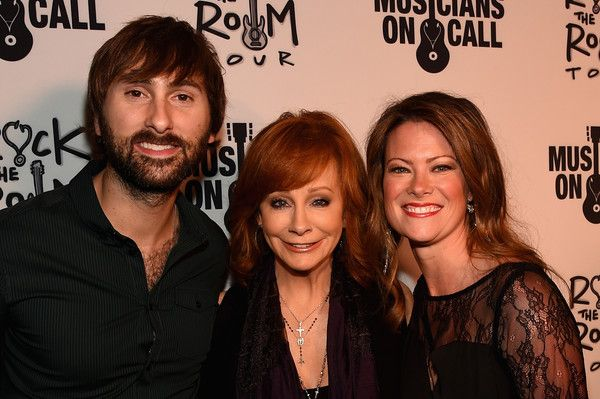 Reba McEntire Photos Photos - Lady Antebellum's Dave Haywood, Reba, and Kelli Cashiola attend the Musicians On Call Rock The Room Tour Kickoff Party at City Winery on October 21, 2015 in Nashville, Tennessee with the help of Reba, Martina McBride, Kelsea Ballerini and more to support its bedside tours for patients in hospitals. Learn more at www.musiciansoncall.org. - Musicians on Call Launches Rock the Room Tour in Nashville