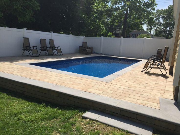 Leisure Fiberglass Pool Reflection Sapphire Blue. Nicolock Paving Stones Travertina and Grey Coping/trim