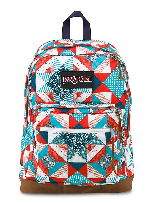 The new classic JanSport Right Pack World Backpack in Multi Yankee Doodle that features a laptop sleeve and the signature suede leather bottom.