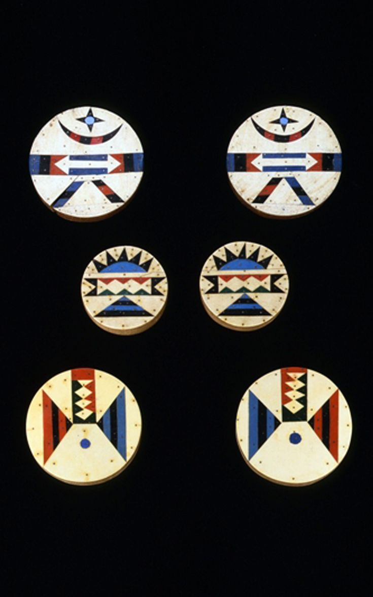 South Africa | 3 pairs of Zulu ear plugs; Wood, asbestos vinyl, metal pins | Decorated on both sides.