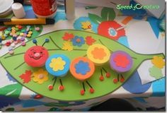 3D caterpillar.  Cut out large leaf from card stock.  Glue colorful circles to plastic water or milk lids.  Arrange and glue on leaf and decorate.