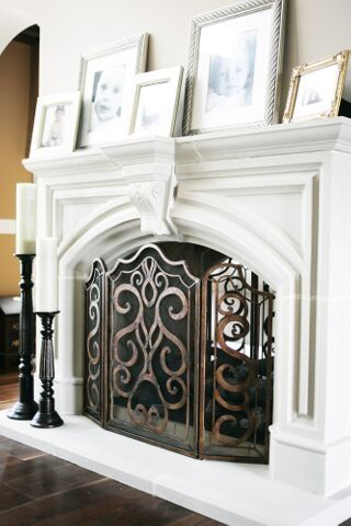 Beautiful Fireplace with Family Photos on Mantel...great screen!