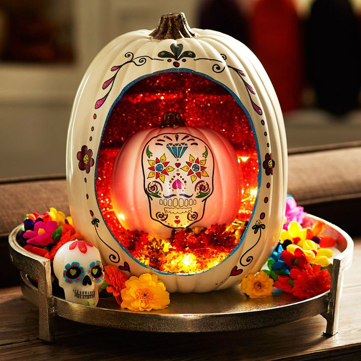 Use a craft pumpkin to create this fabulous  Day of The Dead pumpkin .