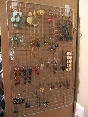 Thrifty way to display earrings and make them easy to wear. Can you believe this is a baking cooling rack?