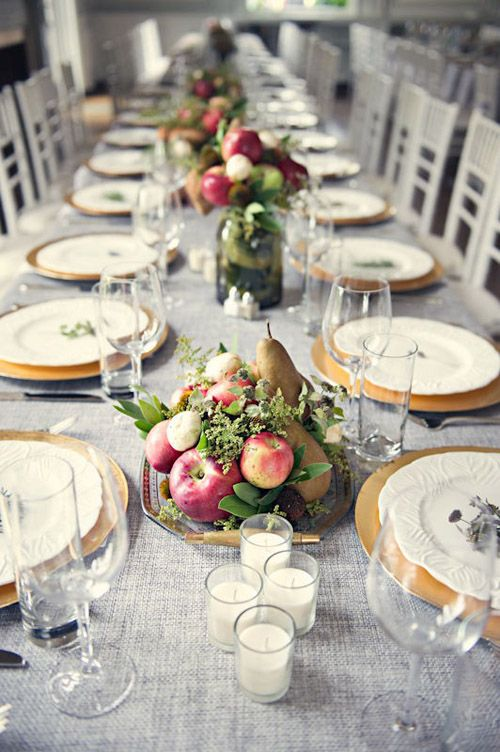 Grey table cloth with gold chargersand fruit displays