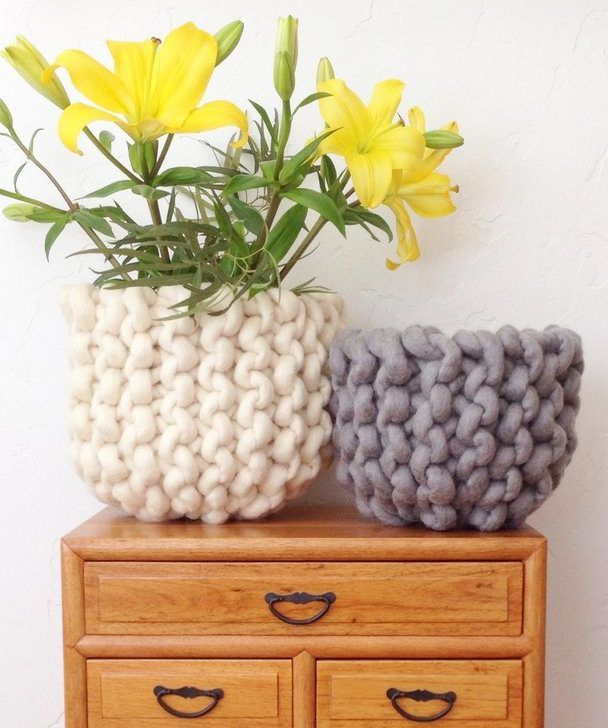 Free Knitting Pattern for Ridge Basket - Simple garter stitch in jumbo yarn is seamed and cinched to create a modern basket that's a beautiful accent to a planter or vase with flowers. Designed by Love Fest Fibers