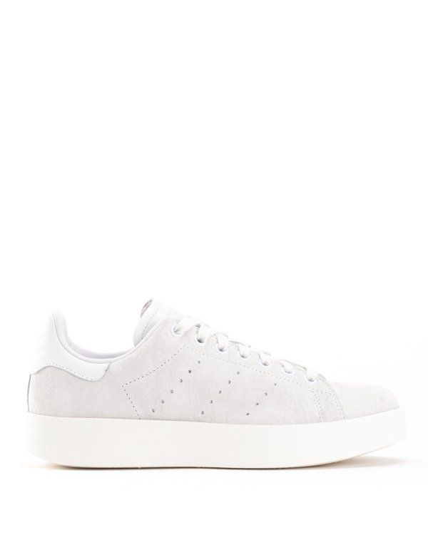The adidas Women s Stan Smith Bold in Crystal White Gold. - Suede upper -  Perforated 3-Stripes - Debossed logo on leather tongue - Synthetic leather  lining ... a8f35ff06