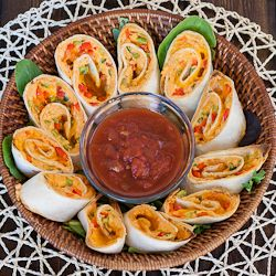Antojitos Appetizers ~ the ultimate appetizer... cream cheese, red peppers, green peppers, jalapeno,  cheddar cheese and hot sauce. You mix all that together and spread it over a tortilla. Tastes just like Montana's!