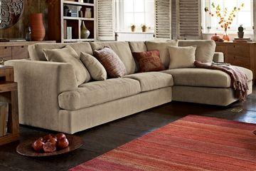 Large neutral corner sofa with orange accents