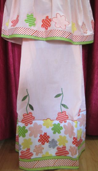 Peach color pinstripes cotton fabric with tape laces, and applique flowers formed from the cotton floral panel at the bottom. http://feisa.weebly.com/ridas.html