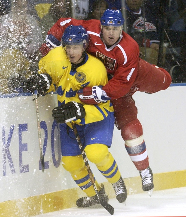 Jaroslav Spacek of the Czech Republic crashes into Sweden's Jorgen Jonsson during a 2-1 victory for Sweden in a preliminary-round men's hockey game at the E Center in West Valley City.