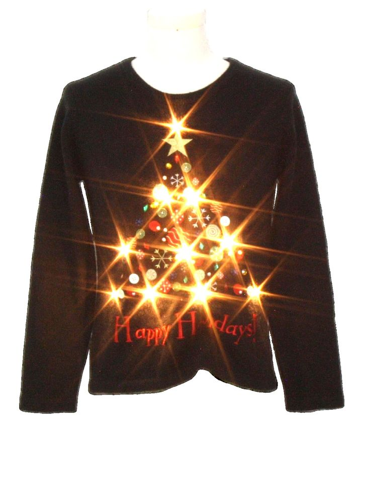 Womens Lightup Ugly Christmas Sweater: -Missing Label- Womens black background acrylic pullover longsleeve Ugly Christmas White Flashing Lightup (10 super bright removable WHITE Flashing or Solid lit dual mode LED lights powered by included L4 watch Batteries) Sweater with round neckline. Featuring button, beaded and faux gem decorated lit up Christmas tree on the middle front with -Happy Holidays- embroidered in red on the middle front. Plain black on back.