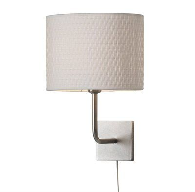Instead of the traditional lamps set on the bedside table...