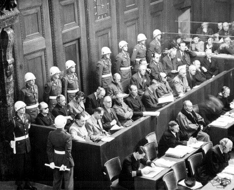 The defendants at Nuremberg. Front row, from left to right: Hermann Göring, Rudolf Hess, Joachim von Ribbentrop, Wilhelm Keitel, Ernst Kaltenbrunner, Alfred Rosenberg, Hans Frank, Wilhelm Frick, Julius Streicher, Walther Funk, Hjalmar Schacht. Back row from left to right: Karl Dönitz, Erich Raeder, Baldur von Schirach, Fritz Sauckel, Alfred Jodl, Franz von Papen, Arthur Seyss-Inquart, Albert Speer, Konstantin van Neurath, Hans Fritzsche.