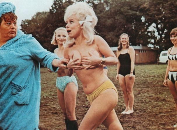 Matron (Hattie Jacques) takes them away as Babs (Barbara Windsor) falls out of the exercise class in Carry On Camping.