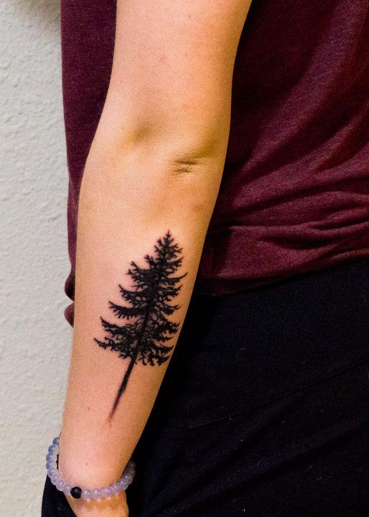 Spruce tree silhouette tattoo