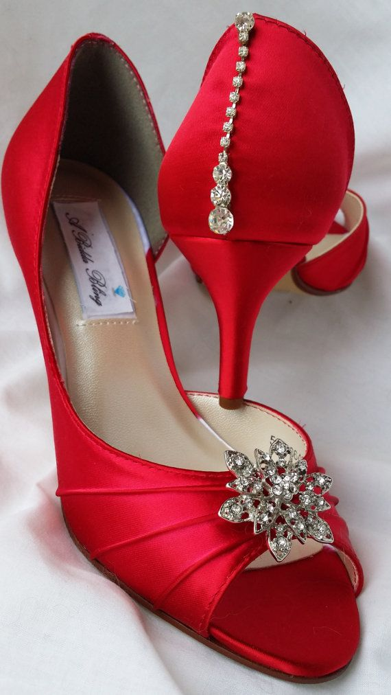 Red Wedding Shoes. Lovely pair of red bridal shoes embellished with a a vintage style flower rhinestone brooch on the front of the shoe and a crystal teardrop design on the back of the shoe. So pretty! The shoes in the listing have been dyed a beautiful Valentine Red, but is available in