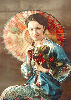 Antique Edwardian autochrome photo of a beautiful young woman with a Japanese parasol, wearing a kimono.