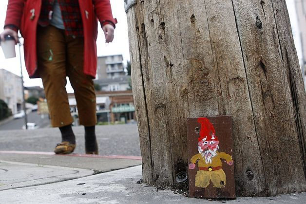 """Painted gnomes bring smiles in Oakland"" A gnome is screwed into the base of a utility pole at Newton and Wesley avenues. Photo by: Liz Hafalia, The Chronicle."