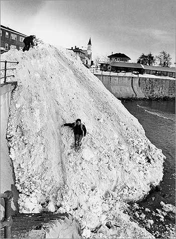 Our look at scenes from the Blizzard of 1978, compared with more recent ones, by Boston Globe photographers starts north of the city, in Swampscott at the  Lynn line. Snow removed from streets during the blizzard was dumped off  King's Beach.