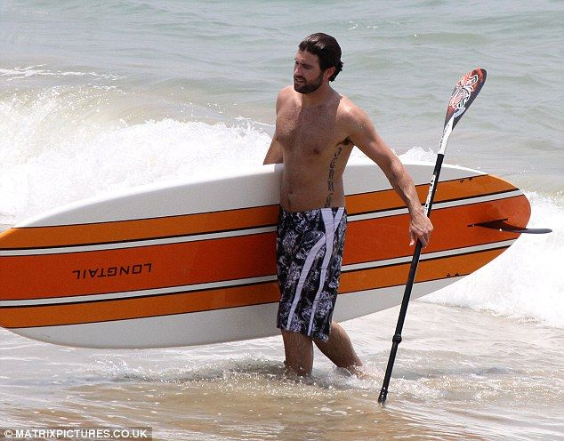 Surfboard: Brody Jenner showed off his muscular physique as he exited the sea carrying his board