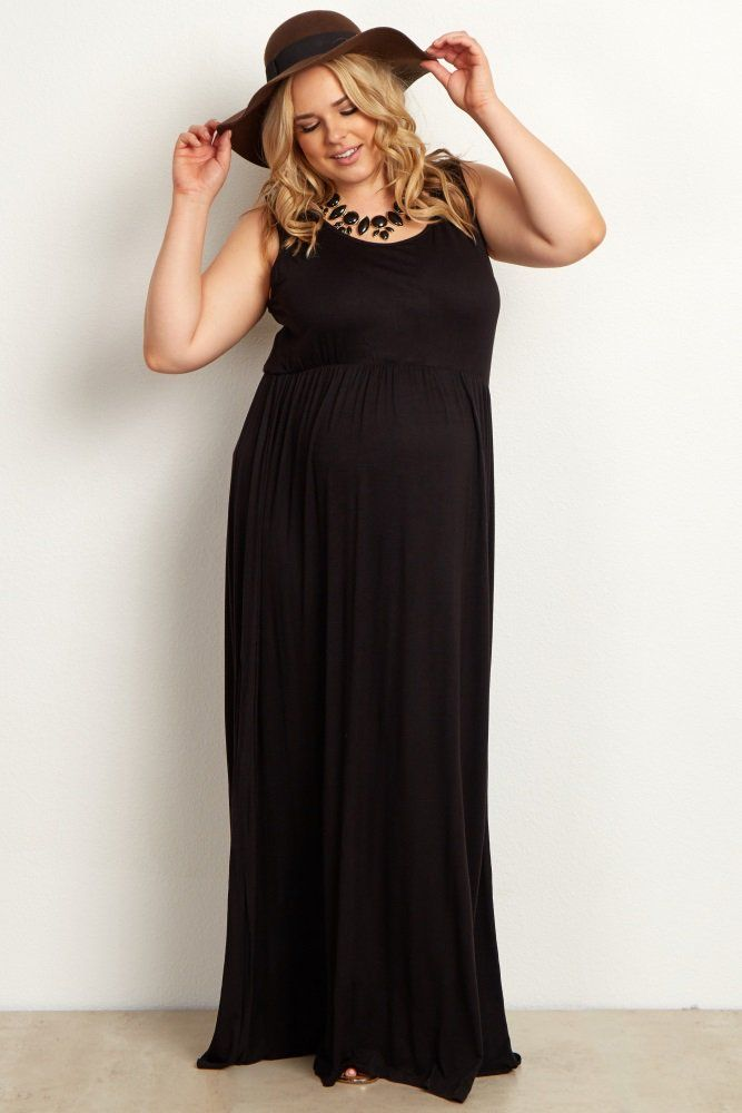 f44f4ed9ad7 A basic sleeveless plus size maternity maxi dress. Rounded neckline.  Cinched under bust.