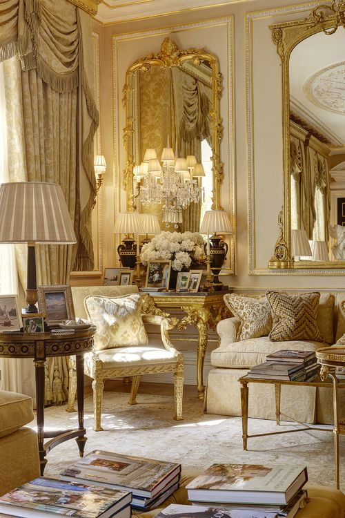 Stunning glamour in the living room.  Rich golds, creams and gilding