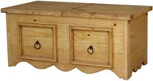 This very affordable rectangular rustic coffee table has the Mexican style we love and the American storage we need.  The top slides to access space perfect for hiding the daily newspaper, boxes of games, or cuddly throws.  Hand made of solid pine with a distressed finish, the southwestern style with its curved foot complements most casual décor.