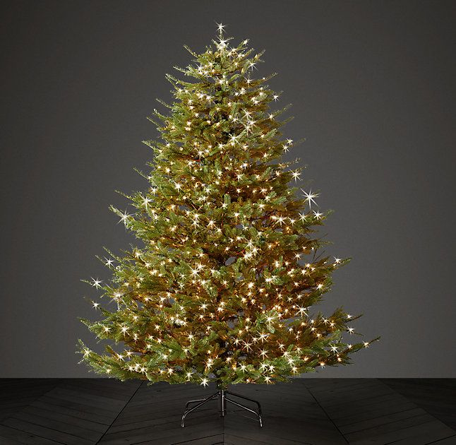 RH's Faux Noble Fir Tree With Illuminate Technology - Incandescent Bulbs:Our faux Noble Fir Tree makes a shimmering statement with pre-strung incandescent bulbs that illuminate as trunk sections are connected. The hand-wrapped branches are adjustable for artful ornament placement and feature lifelike tips.