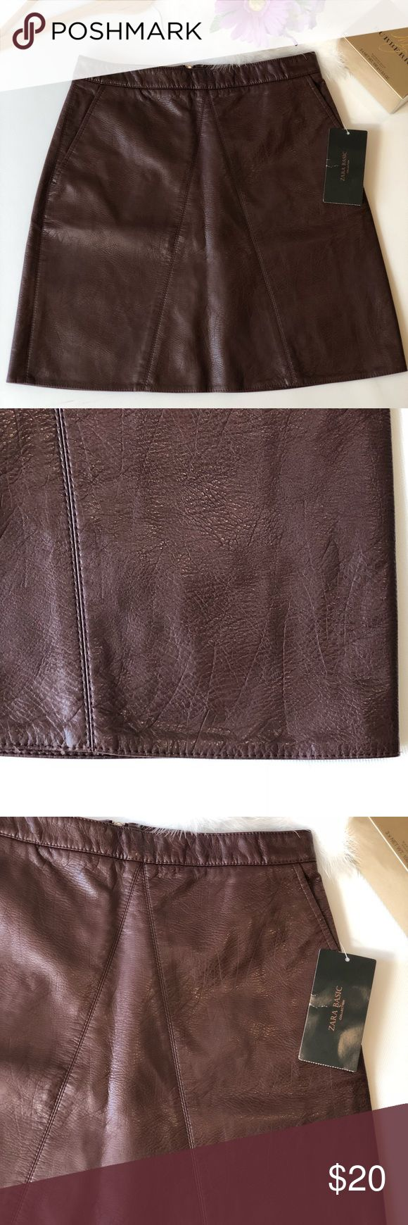 """Zara Basic Faux Leather Maroon brown mini skirt S NWT Zara Basic mini skirt. Maroon brown color . Size S. Please see pictures for fabric information. Front pockets. Back zipper. ALL MEASUREMENTS ARE APPROXIMATELY AND LAYING FLAT: 🔸LENGTH: 17"""" 🔸WAIST: 13"""" 🔸HIPS: 17.5""""  FEEL FREE TO ASK QUESTIONS  I DO NOT TRADE. Zara Skirts Mini"""