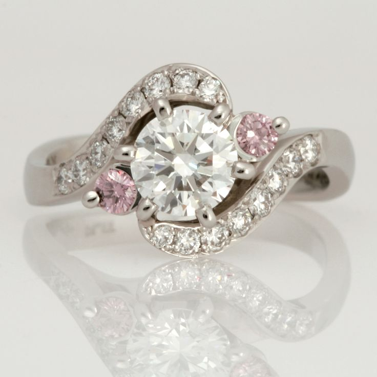 Ladies platinum diamond engagement ring featuring pink and white diamonds.
