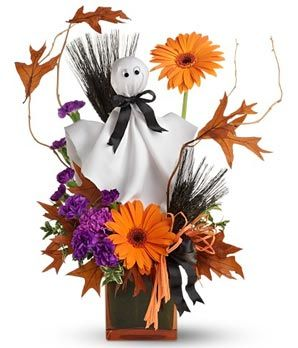 Flowers with a ghost for a Halloween theme.