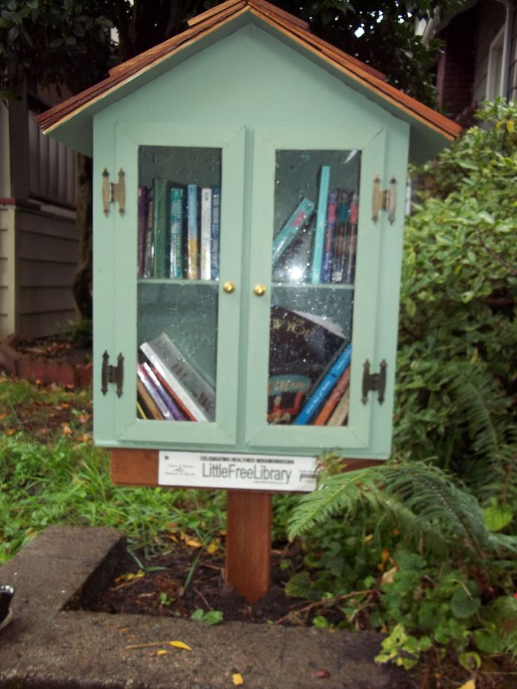 """Little Free Library, Portland, Oregon. Libraries with """"tree books"""" are going away in many communities. Keep the books alive!"""