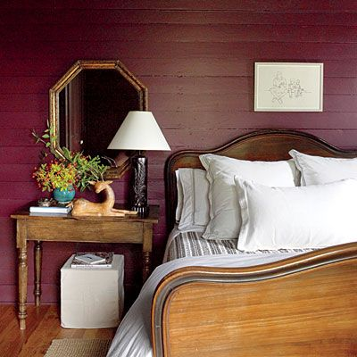 Earthy Guest Room | The walls and ceiling are painted a rich eggplant hue (Brinjal by Farrow & Ball) to establish a moody, earthy feel that's reinforced by dark wood and gilt finishes.