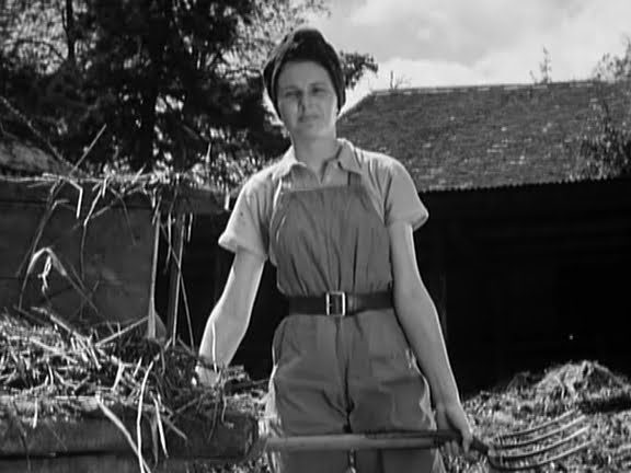 Headscarf, dungarees and a belt - but unmistakably all woman. Showing how to rock the farmhand look from the film A Canterbury Tale.