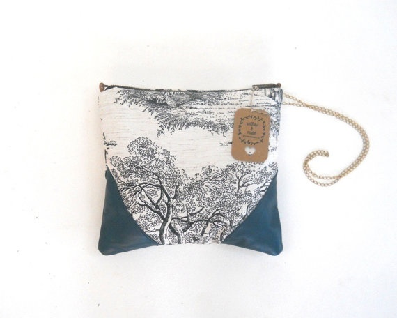 Leather and fabric bag with antique brass strap