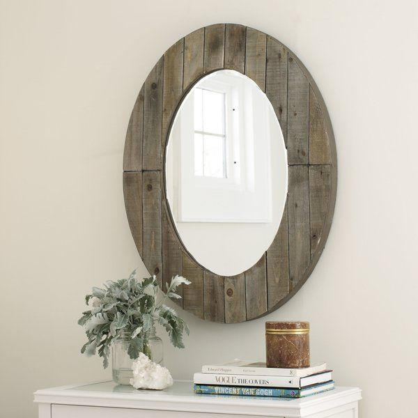 This wood plank-framed mirror hits all the right notes when it comes to casual, rustic style that supports nautical- and lodge-inspired looks.
