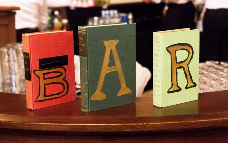 Books as signs - great for library wedding theme Hayley and Jeff- Los Angeles Library Wedding » Ryon:Lockhart Photography Huslte & Bustle