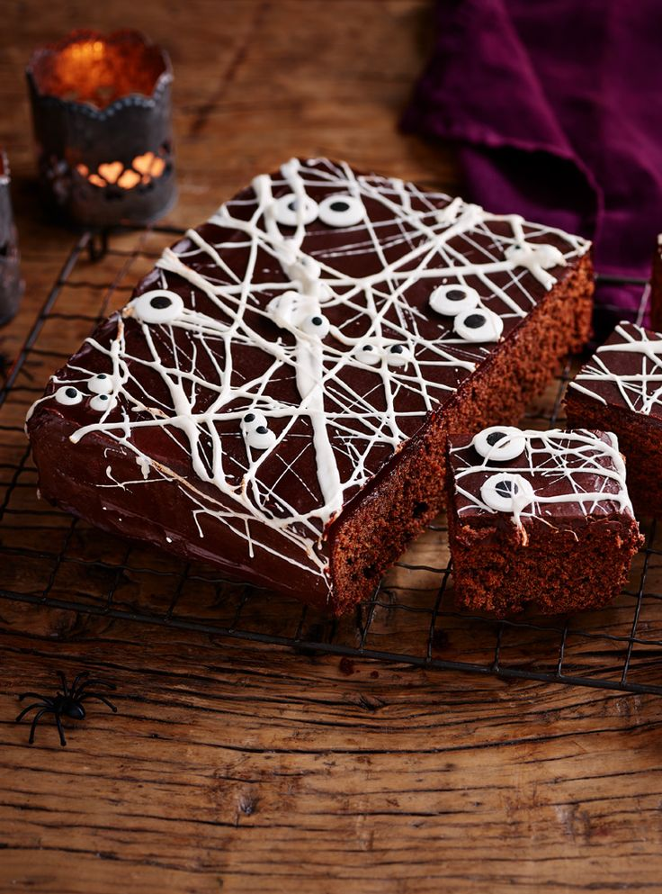 This Halloween cake is so easy, it's spooky! Just stretch out some melted marshmallows to make a cobweb cover and add candy eyes.