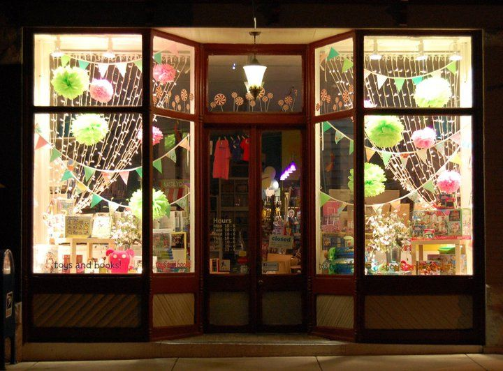 Use bunting to help frame your retail window display!  It can be made easily using coloured paper and string or purchase fabric styles from Etsy for a great price!
