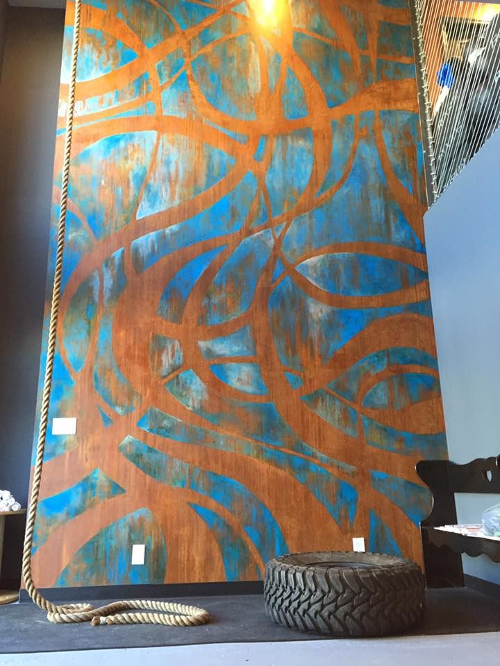 Amazing Wall Treatment with Metal Effects and a modern ornamental design for Our House Studios Sports & Recreation facility | Rust Patina Mural | Amazing project by Ali Kay of Positive Space