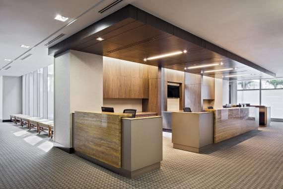 Nursing workstations include areas for patient/family interaction with adjacency to decentralized clean/soiled holding areas. The casework was fabricated from durable phenolic-replicating wood veneer and metal finishes, with natural stone at the transaction zones. Photo: Owen Raggett