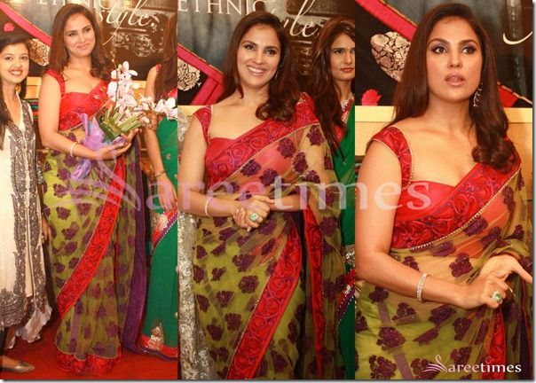 Bollywood actress Lara Dutta in beautiful green designer shimmer faux georgette saree, embellished with patch work all over saree and red lace border,patch work on it paired with designer sleeveless saree blouse with wide neck pattern at Chhabra 555 Collection Unveiling.